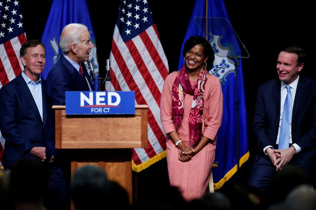 Former Vice President Joe Biden turns to speak to candidate for Congress Jahana Hayes, as candidate for governor Ned Lamont, left, and incumbent candidate  U.S. Sen. Chris Murphy, right, look on at a rally supporting Democrat candidates in Hartford, Conn., Friday, Oct. 26, 2018. (AP Photo/Jessica Hill)