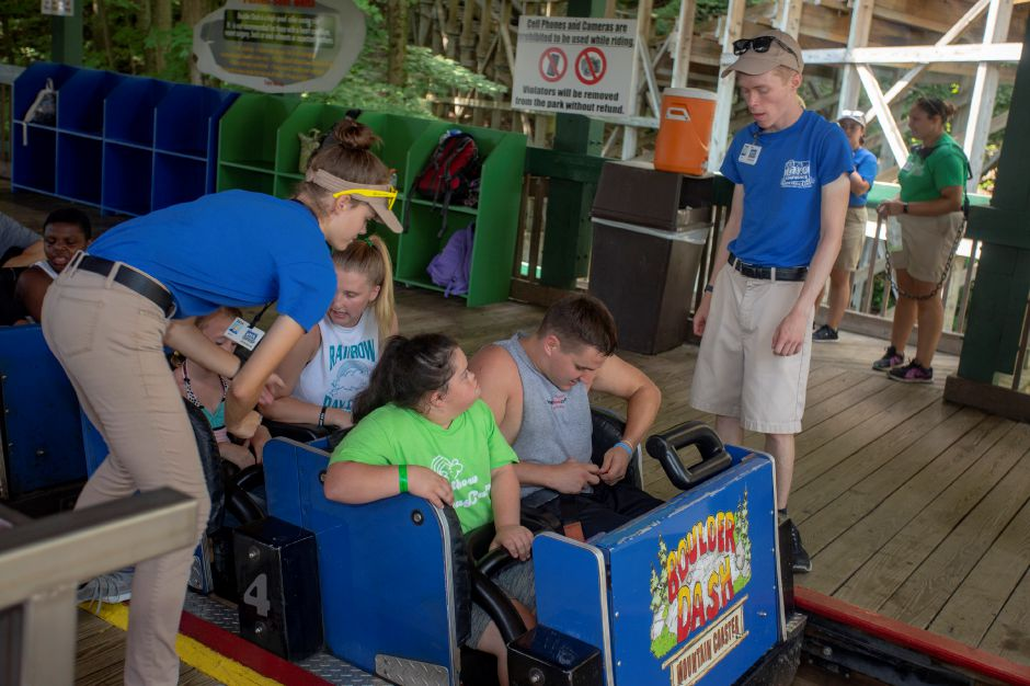 Lake Compounce staff help riders get secure in their seats Aug. 8, 2018. | Richie Rathsack, Record-Journal