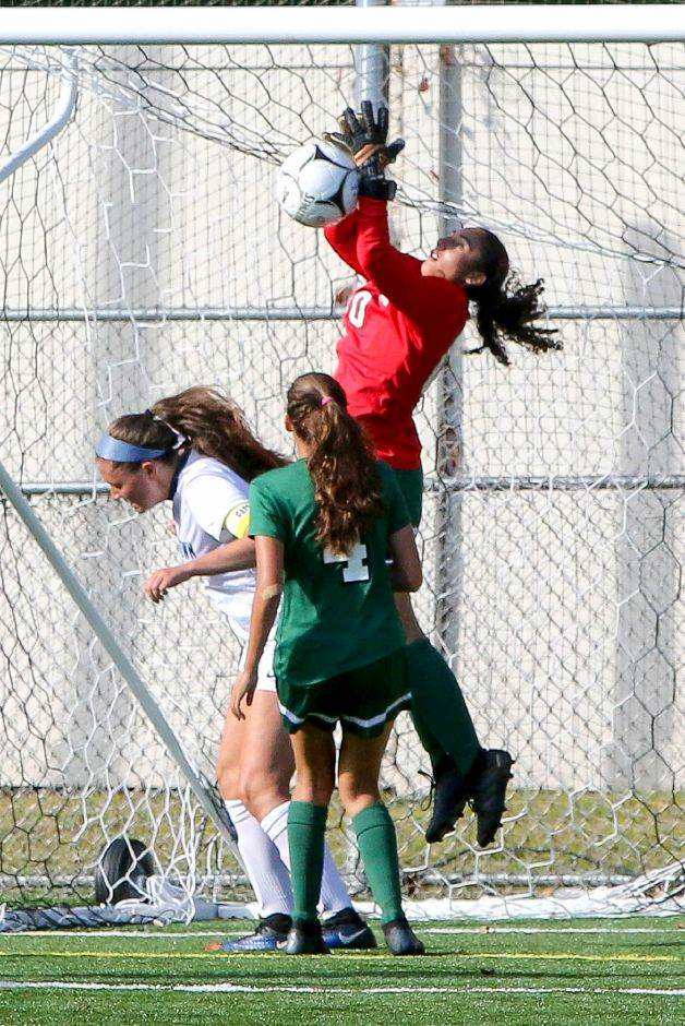 Maloney goalie Abby Lespier, seen here in action against Middletown during the regular season, had nine saves in the Spartans on Tuesday in their 3-0 loss in East Lyme in the first round of the CIAC Class L girls soccer tournament. | Aaron Flaum, Record-Journal