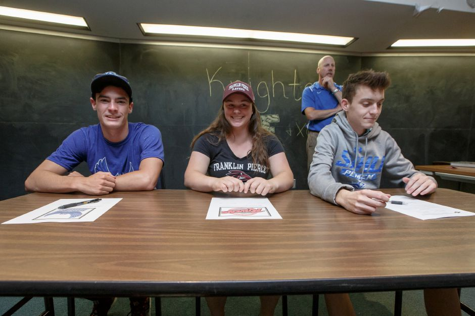 Southington seniors Zach Burleigh, Julia Groll and Conner Leone signed their National Letters of Intent on Thursday in the Southington High School library. Burleigh, on the left, is going to SCSU. Groll, in the middle, is going to Franklin Pierce. Leone, on the right, is bound for Southern New Hampshire. | Justin Weekes / Special to the Record-Journal