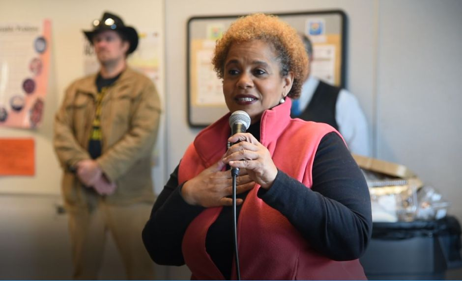 Ethel Higgins, executive director of Amazing Grace in Middletown, thanks over 500 volunteers gathered at Coginchaug Regional High School for the 13th annual Community Round-up in Durham and Middlefield on Saturday, Dec. 1, 2018. The event collected more than 13,000 food items and about $3,500 to go to Durham and Middlefield Social Services, and Amazing Grace in Middletown. | Bailey Wright, Record-Journal