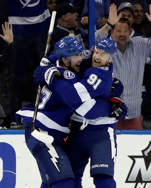 Tampa Bay Lightning defenseman Victor Hedman (77) and center Steven Stamkos (91) celebrate after Hedman scored against the Philadelphia Flyers during the third period of an NHL hockey game Saturday, March 3, 2018, in Tampa, Fla. The Lightning won the game 7-6 in a shootout. (AP Photo/Chris O