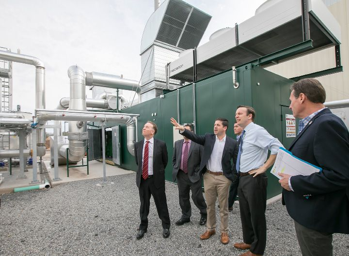 U.S. Sen Chris Murphy, D-Connecticut, second from right, is led on a tour of Quantum Biopower in Southington by Brian Paganini, vice president and managing director, Wednesday, April 12, 2017. The recycling plant converts common food waste into combustible gas and energy. | Dave Zajac, Record-Journal