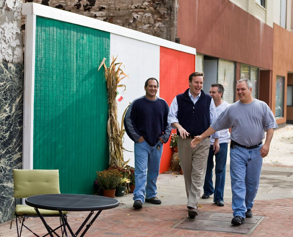 From left Ross Gulino, Chris Murphy, and Dave Salafia walk back into Pies Ons after taking a group picture in front of the recently approved Italian flag painted wall on Colony St. in Meriden, Nov. 5, 2008. Murphy stopped at the restaurant to thank supporters after he was re-elected to the U.S. House of Representatives. (Christopher Zajac/Record-Journal)
