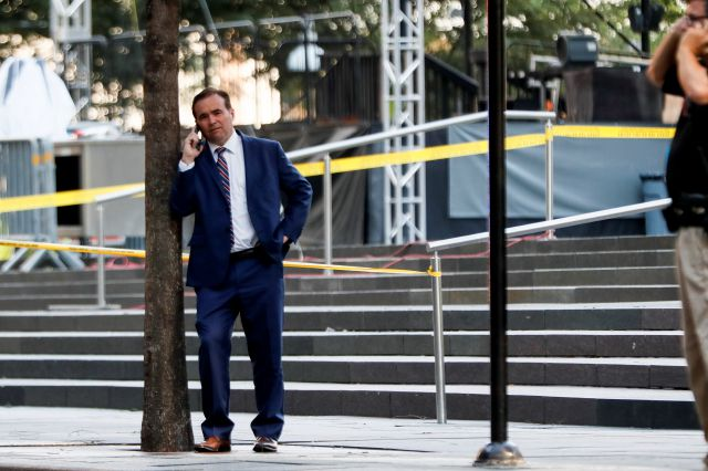 Cincinnati Mayor John Cranley stands at the scene as emergency personnel and police respond to reports of a shooting near Fountain Square, Thursday, Sept. 6, 2018, in downtown Cincinnati. (AP Photo/John Minchillo)