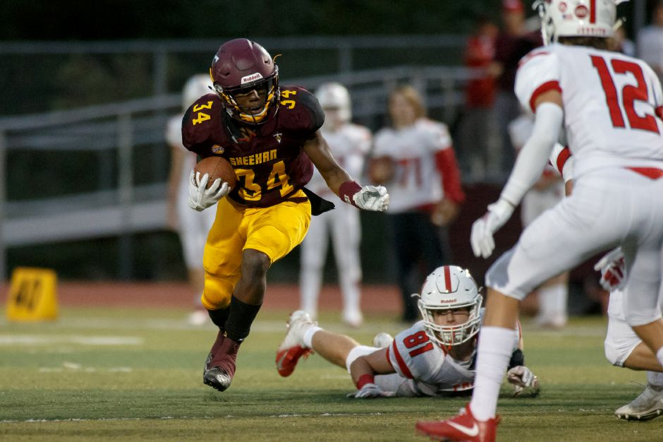 Sheehan running back Terrence Bogan rushed for two touchdowns Friday night in a 28-8 Titans victory over Griswold at Riccitelli Field. | Justin Weekes / Special to the Record-Journal