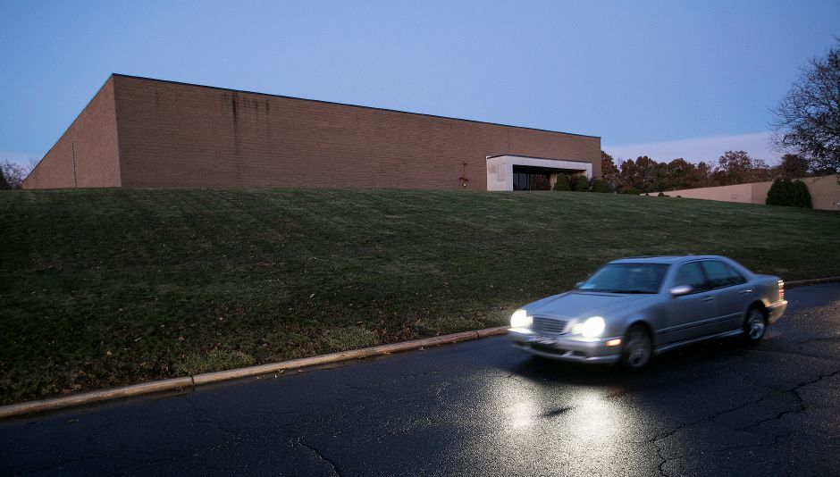 A motorist passes a vacant warehouse at 30 Fieldstone Ct. in Cheshire, Thursday, Nov. 16, 2017. An ammunition seller with a warehouse in Southington plans to renovate and move into the building. | Dave Zajac, Record-Journal