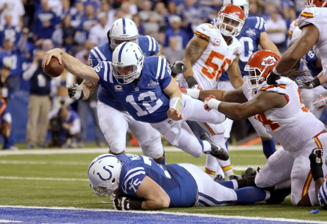 FILE - In this Jan. 4, 2014, file photo, Indianapolis Colts quarterback Andrew Luck (12) dives for a touchdown after recovering a fumble by the Colts