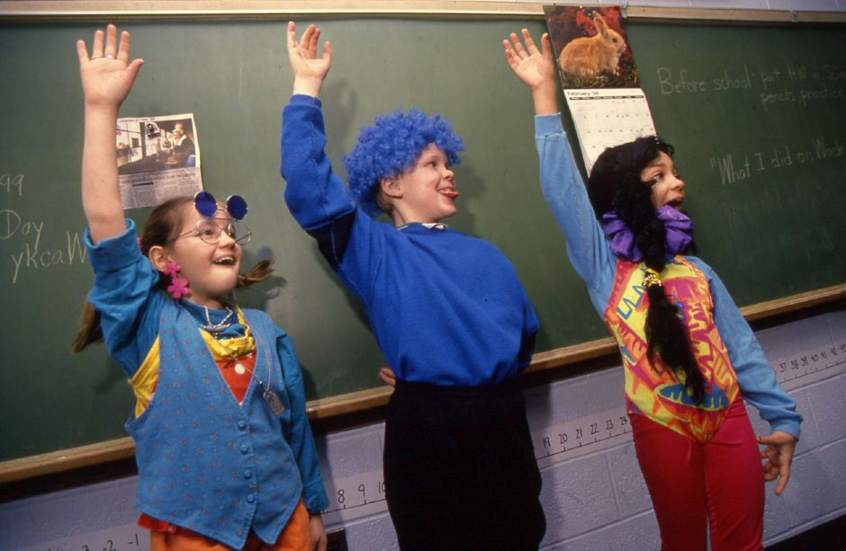 "RJ file photo - From left, Anna Rumi, Andrew Anziano and Jaime Perry show off their finest ""Wacky Wednesday"" attire at E.C. Steven School in Wallingford, Feb. 1994."
