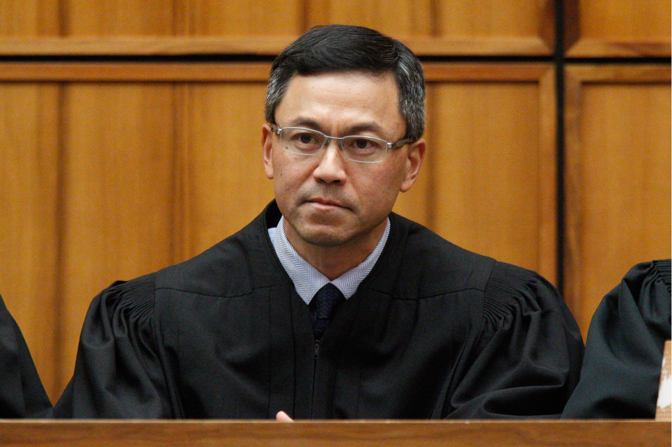 This December 2015 photo shows U.S. District Judge Derrick Watson in Honolulu. Hours before it was to take effect, President Donald Trump