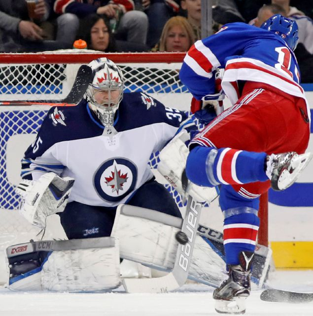 New York Rangers right wing Jesper Fast (17) of Sweden takes a shot against Winnipeg Jets goaltender Steve Mason (35) during the first period of an NHL hockey game in New York, Tuesday, March 6, 2018. (AP Photo/Kathy Willens)