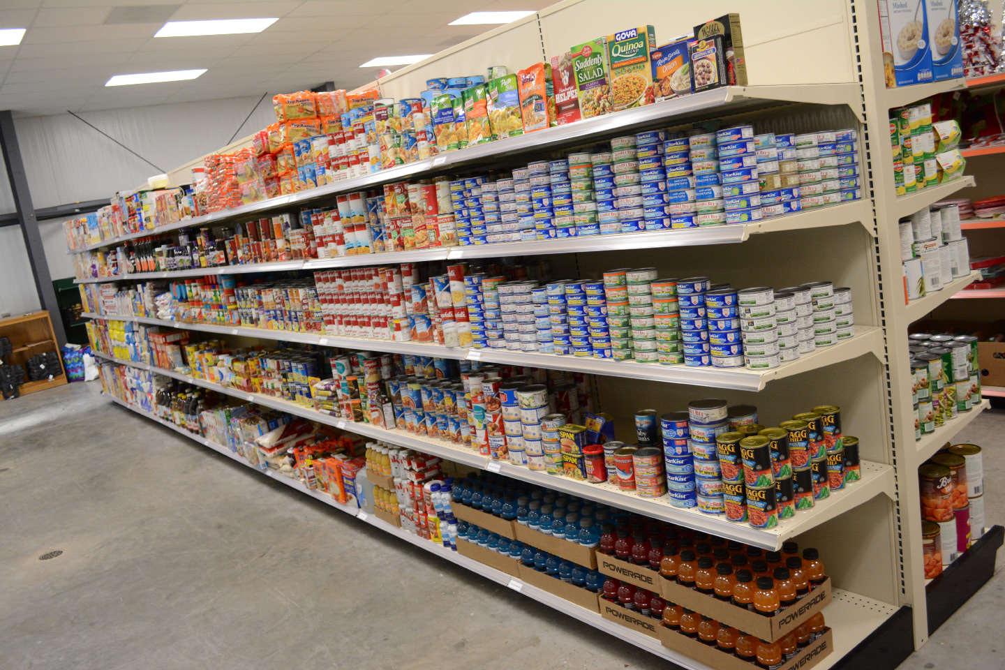 Food on shelves at the Cheshire Community Food Pantry on Friday, Dec. 2. | Bryan Lipiner, Record-Journal