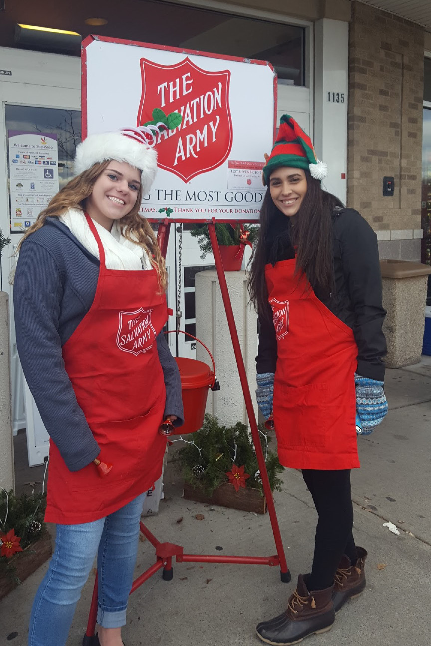 Members of the Berlin High School Interact Club rang the Salvation Army kettle bell recently. The club raised $1,030 in two days. From left: Alina Whiteside and Gabby Pattavina.
