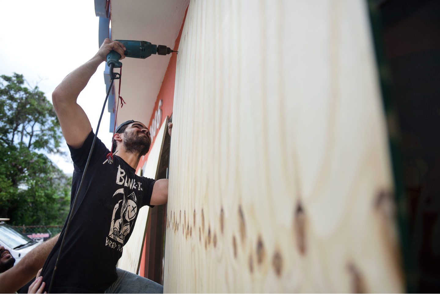 Cyber School Supply employee Christopher Rodriguez installs wood panels on windows in preparation for Hurricane Irma, in Toa Baja, Puerto Rico, Tuesday, Sept. 5, 2017. Irma grew into a dangerous Category 5 storm, the most powerful seen in the Atlantic in over a decade, and roared toward islands in the northeast Caribbean Tuesday. (AP Photo/Carlos Giusti)