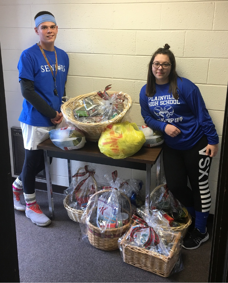 Students in the Plainville High School Science National Honor Society  recently donated six Thanksgiving baskets to local families in need. From left: Jordan Jones, Science National Honor Society President; and Nichole Page, Public Relations Officer.
