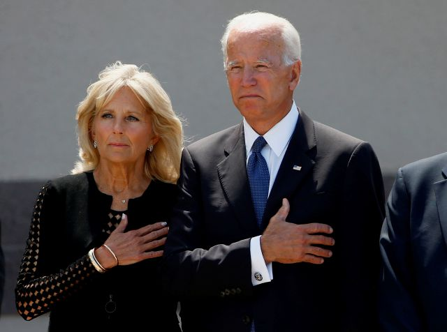 Former Vice President Joe Biden, right, and his wife Jill Biden, pause with hands over their hearts as they watch a military honor guard place the casket of Sen. John McCain, R-Ariz., into a hearse after a memorial service at North Phoenix Baptist Church Thursday, Aug. 30, 2018, in Phoenix. (AP Photo/Ross D. Franklin)