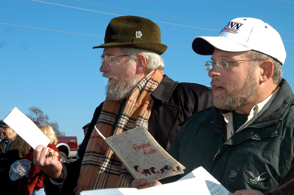 Tom McGrath and Doug Schultz sing some Christmas carols during the Francisean Life Center