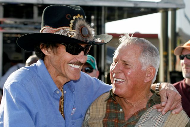 FILE - In this Friday, March 6, 2009 file photo, former NASCAR drivers Richard Petty, left, and David Pearson share a laugh during practice for the Kobalt 500 NASCAR Sprint CUp auto race at Atlanta Motor Speedway in Hampton, Ga. NASCAR's Silver Fox David Pearson has died at 83. Pearson was a three-time Cup champion and his 105 career victories trail only Richard Petty