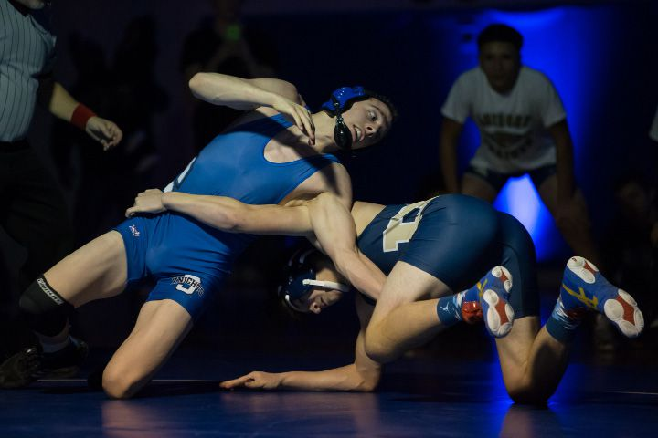 Southington's Jason Calvi-Rogers reverses the hold on Platt's Christian Rivera Wednesday at Southington High School. | Justin Weekes / For the Record-Journal