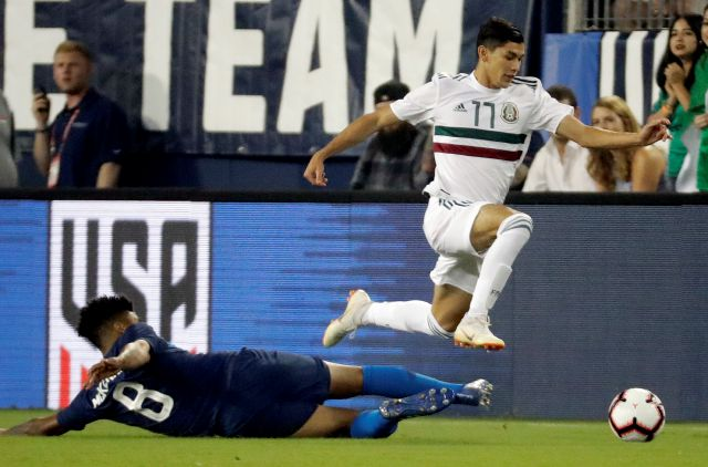 Mexico midfielder Elias Hernandez (11) moves the ball past U.S. midfielder Weston McKennie (8) during an international friendly match Tuesday, Sept. 11, 2018, in Nashville, Tenn. (AP Photo/Mark Humphrey)