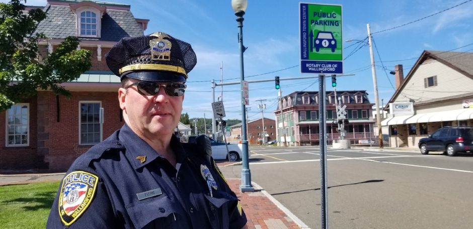 Sgt. David Blythe stands near the Hall Avenue rail crossing in Wallingford, Fri., Sept. 20, 2019. The police department will participate in a national campaign next week to raise awareness of railroad safety. Jeniece Roman, Record-Journal