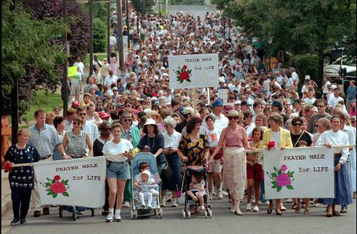 "Anti-abortion protesters begin their ""Prayer Walk for Life"" in State College, Pa., Sunday, August 31, 1997. They are protesting the opening of State College Medical Services, a medical center which plans to offer elective abortions. The center would be the only abortion clinic in the county. (AP Photo/Craig Houtz)"