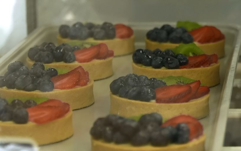 Fruit tarts in the case.