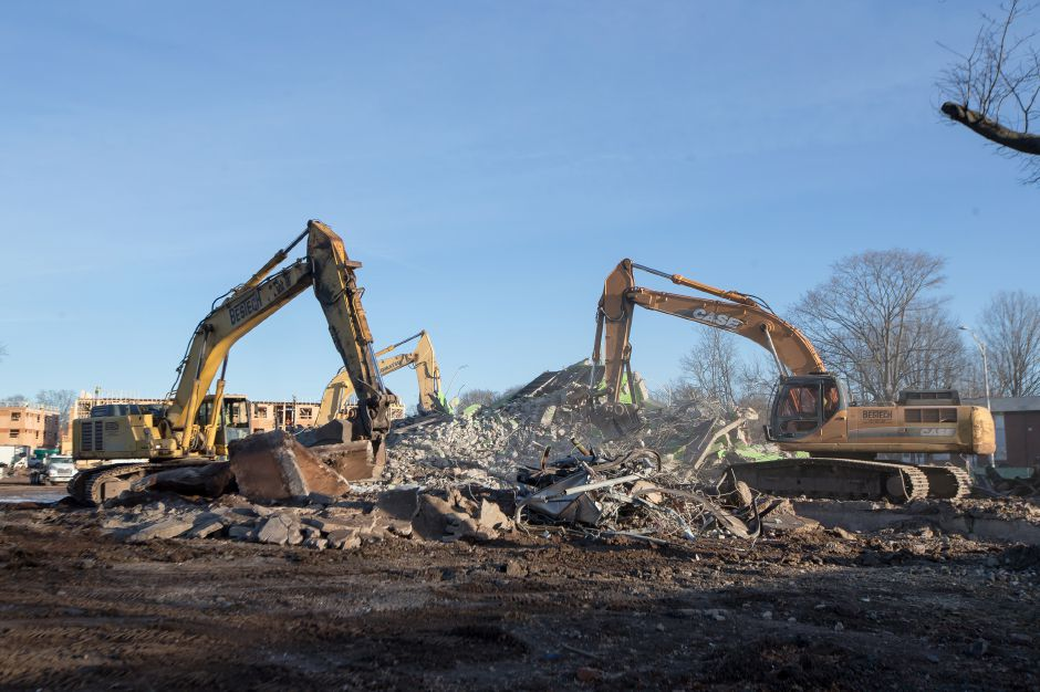 Demolition crews use excavators to break up the remains of the last Mills Apartment building Thursday in Meriden December 27, 2018 | Justin Weekes / Special to the Record-Journal