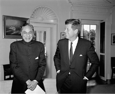 President John F. Kennedy shares a laugh with India?s new ambassador to the United States Braj Kumar Nehru. The new envoy called at the White House, Washington, Sept. 21, 1961 to present his credentials. (AP Photo)