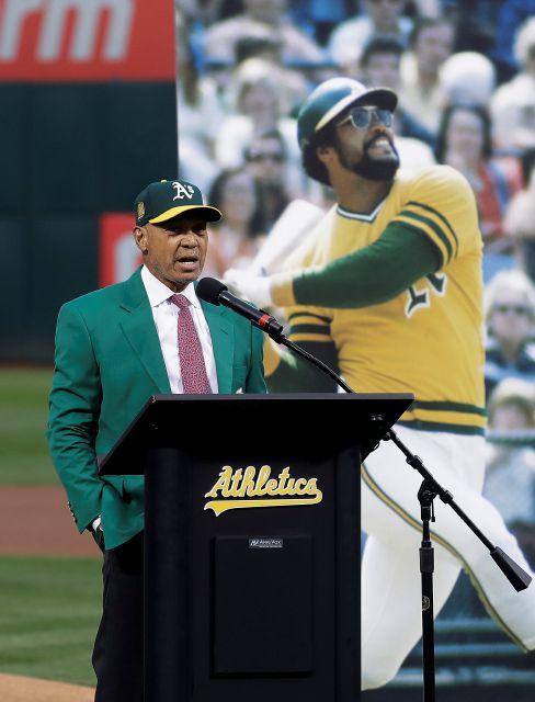 Former baseball player Reggie Jackson speaks during a ceremony inducting him into the Oakland Athletics