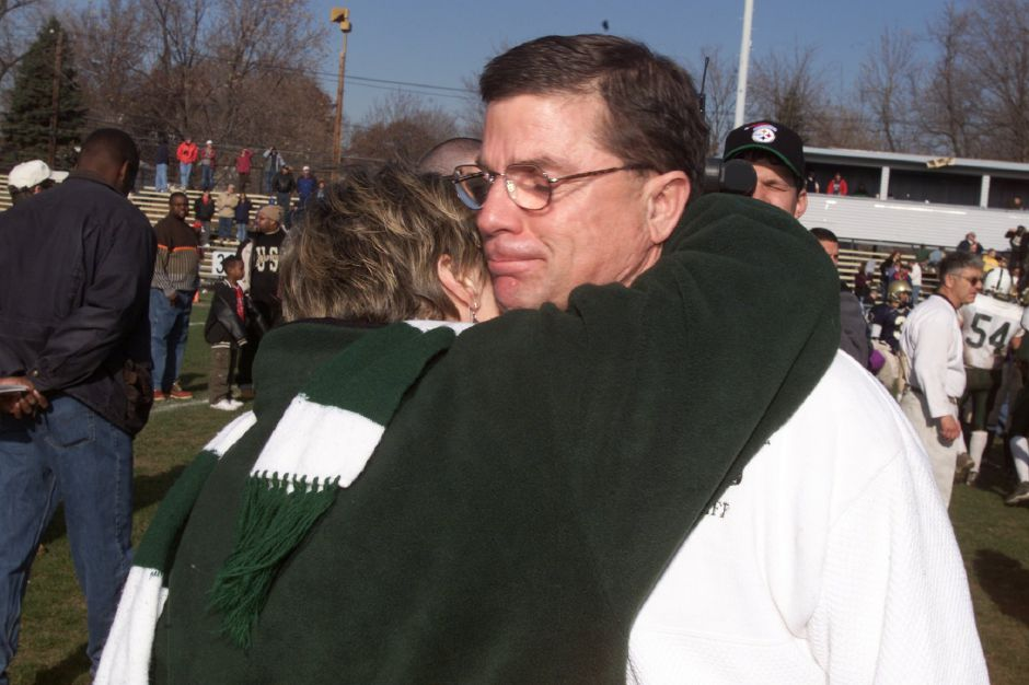 "Rob Szymaszek gets a hug from his wife Diane after his last game as Maloney football coach Thurs., Nov. 22, 2001. He said to her ""I"