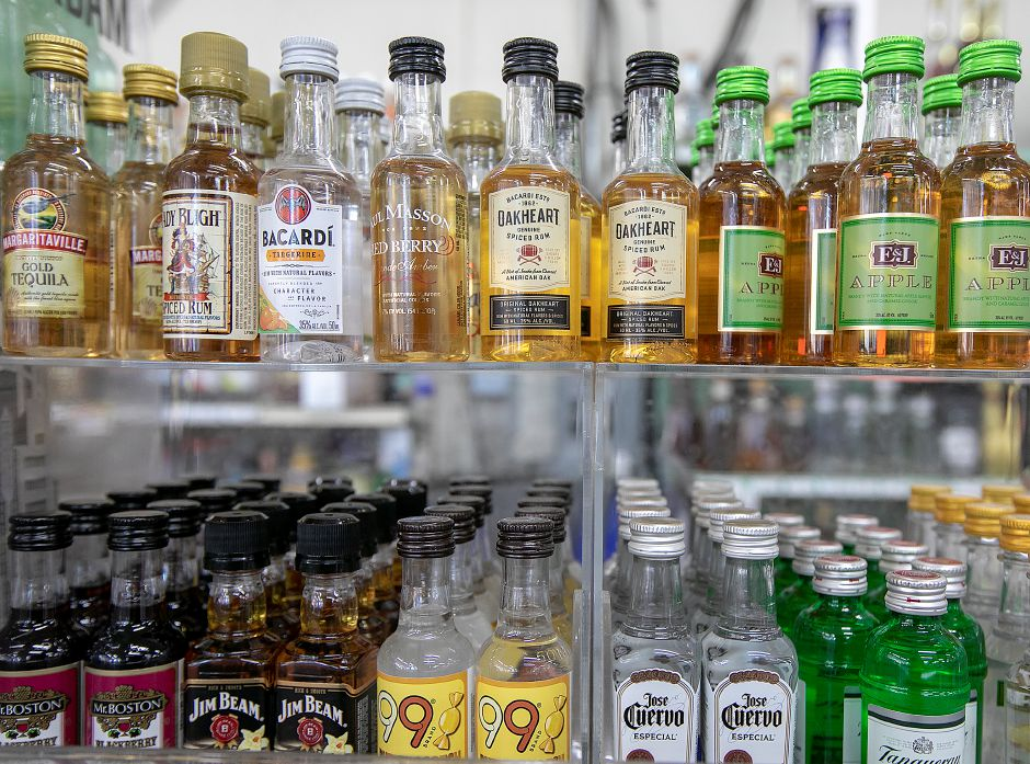 """Nip"" bottles at the Grog Shop of Meriden liquor store on Old Colony Road in Meriden, Thurs., Feb. 21, 2019. Gov. Ned Lamont is proposing a 25 cent deposit on wine and glass liquor bottles and a five cent deposit on miniature ""nip"" bottles in his biennial budget released this week. Dave Zajac, Record-Journal"