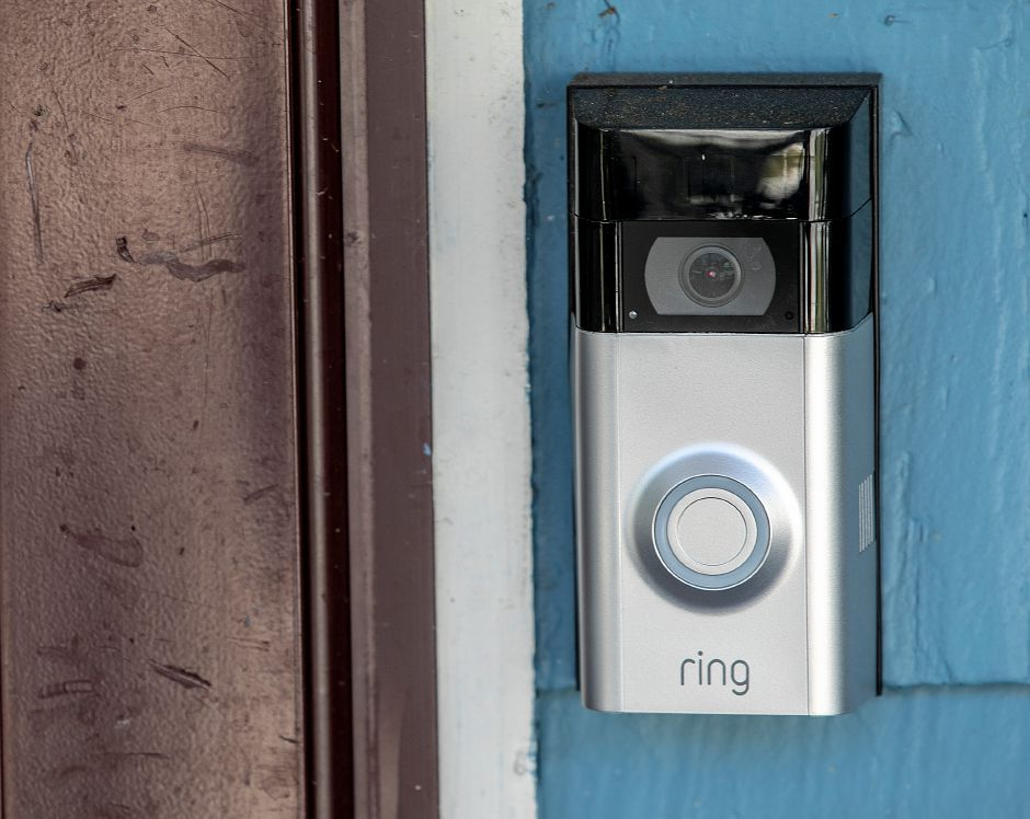 A doorbell surveillance camera next to the front door of Dawn Thomas