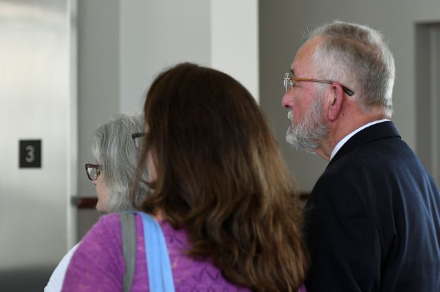 William Strampel, former dean at the College of Osteopathic Medicine at Michigan State University in East Lansing, Michigan, leaves Ingham County Circuit Court with his family, Wednesday, June 12, 2019, after a jury found him guilty of misconduct in office and two charges of willful neglect of duty related to the Nassar scandal. Strampel was found not guilty of sexual assault. (Matthew Dae Smith/Lansing State Journal via AP)