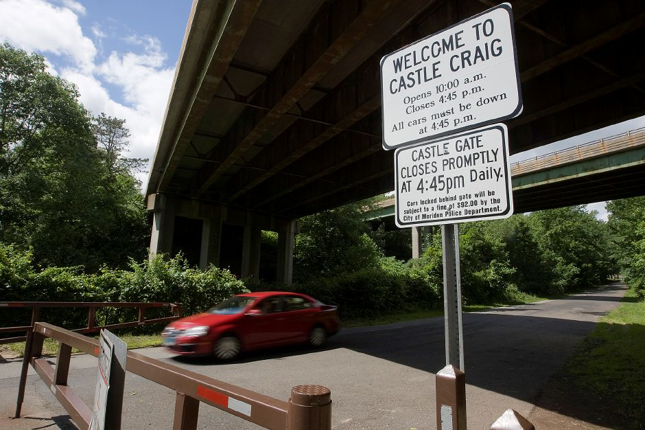 A vehicle passes through the open gate to Castle Craig at Hubbard Park in Meriden, Wednesday, June 12, 2013. Visitors are reminded that the gate closes to vehicle traffic at 4:45 p.m. daily. (Dave Zajac/Record-Journal)