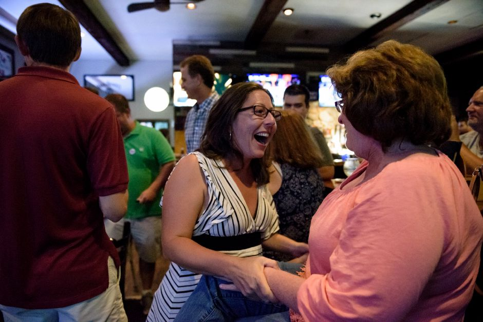 Meriden, CT - 07/18/2018: Sharon Milano (center) celebrates the referendum results in Maloney