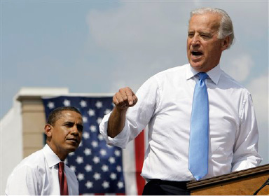 Democratic presidential candidate Sen. Barack Obama, D-Ill., listens as vice presidential running mate Sen. Joe Biden, D-Del., speaks at a rally in front of the Old State Capitol in Springfield, Ill., Saturday, Aug. 23, 2008.(AP Photo/Alex Brandon)