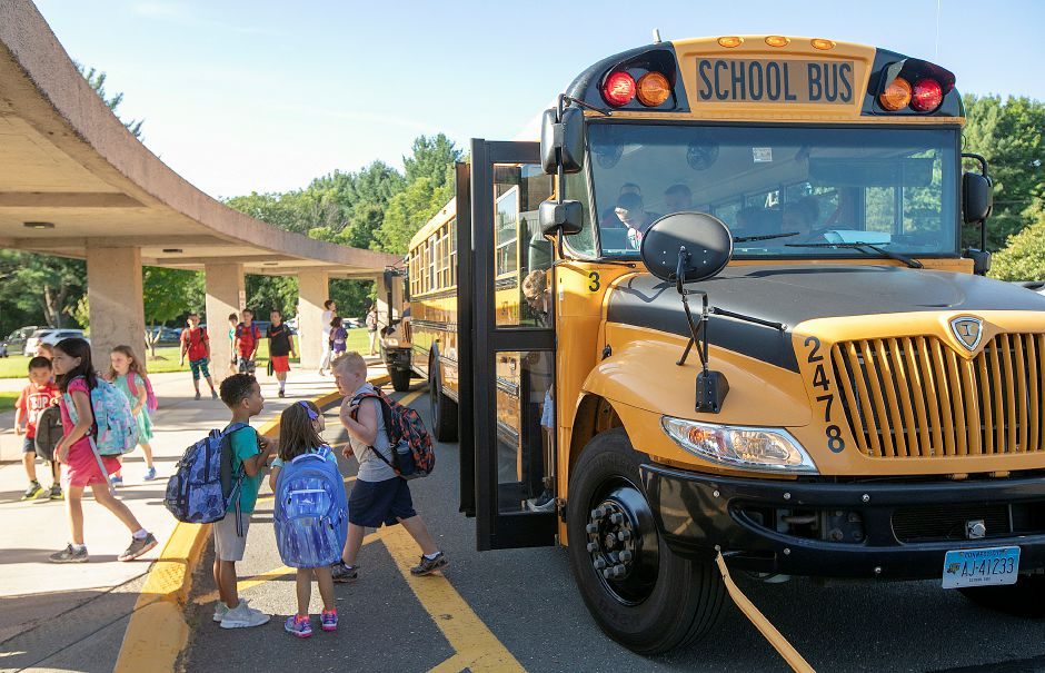 Students arrive on the first day of school Thursday at Highland School in Cheshire.