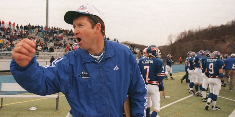 RJ file photo - Southington coach Jude Kelly exhorts his players to cheer on the sidelines Dec. 5, 1998.