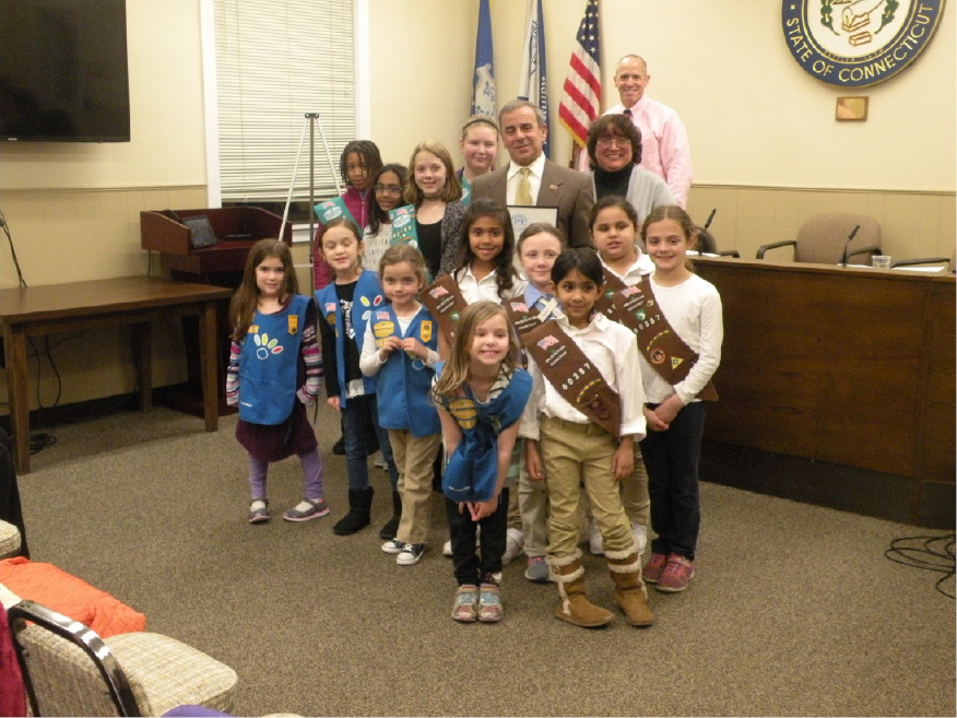 First selectman Mike Freda presented a proclamation to a group of North Haven Girls Scouts to honor the 105th anniversary of the organization. | Ken Liebeskind, The North Haven Citizen