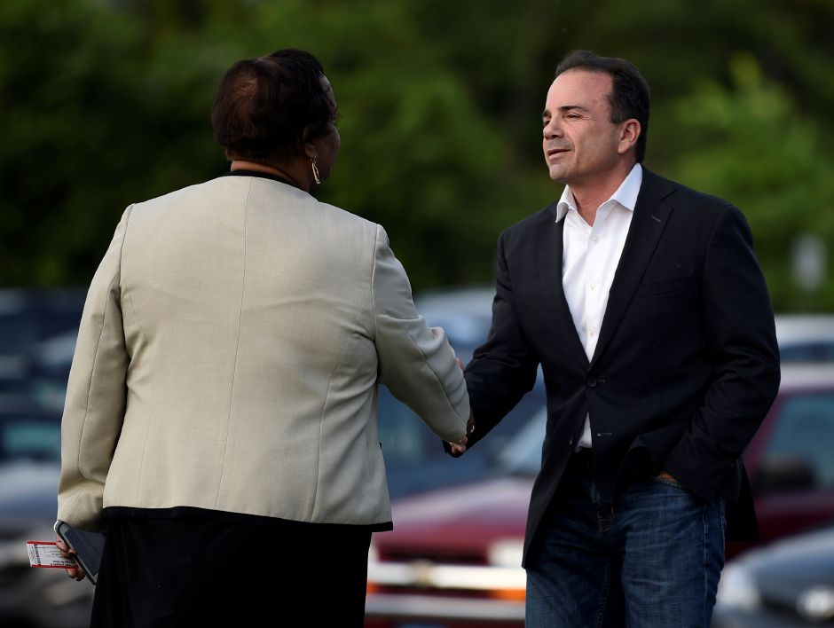 West Hartford, CT - 6/7/18 - Gubernatorial candidate Joe Ganim is greeted by Mildred McNeil, director of marketing and communication for the University of Hartford outside the Lincoln Theater on campus Thursday evening. Though unable to participate in the forum because of forum rules, Ganim was allowed inside to watch the event. Photo by Brad Horrigan | bhorrigan@courant.com