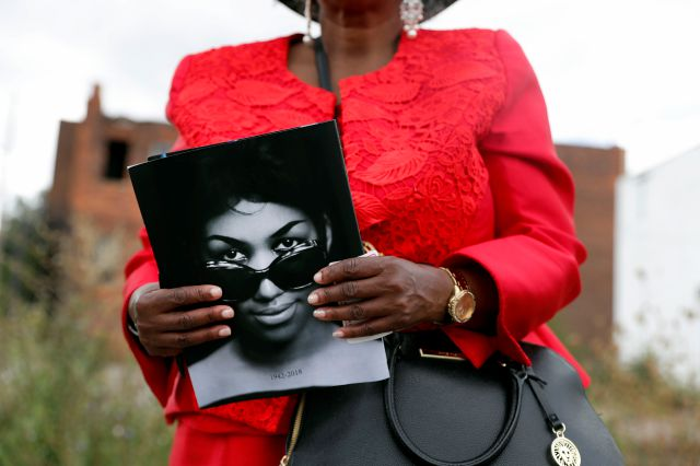 Sharon Napoleon holds a program as she stands outside a viewing for legendary singer Aretha Franklin at New Bethel Baptist Church Thursday, Aug. 30, 2018, in Detroit. Franklin died Aug. 16, 2018 of pancreatic cancer at the age of 76. (AP Photo/Jeff Roberson)