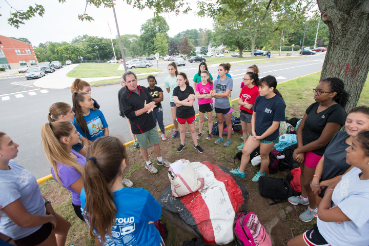 Cheshire head cross country coach Rob Schaefer lays out the day's workout for the team during practice Wednesday at Cheshire High School.  | Justin Weekes, Special to the Record-Journal