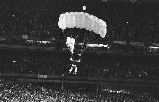 A parachutist identified as Michael Sergio, parachutes down onto the field of New York
