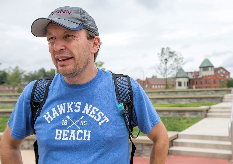 U.S. Senator Chris Murphy talks to reporters on the Meriden Green during his walk across Connecticut, Tuesday, August 15, 2017. | Dave Zajac, Record-Journal