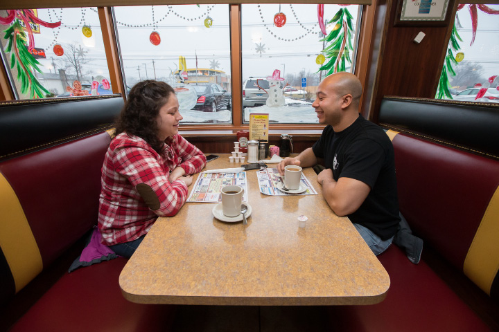Jen Dinis and Cristian Cabera, both of Meriden, enjoy a cup of coffee on Christmas Eve at Colony Diner in Wallingford. | Photos by Justin Weekes, Special to the Record-Journal