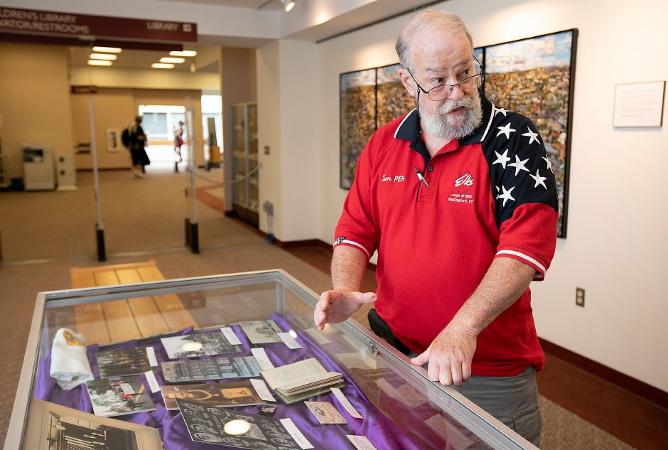 Tom Smith, Elks Past Exalted Ruler, talks about the Wallingford Lodge and national Elks Lodge exhibit at the Wallingford Public Library, Mon., Sept. 16, 2019. Dave Zajac, Record-Journal