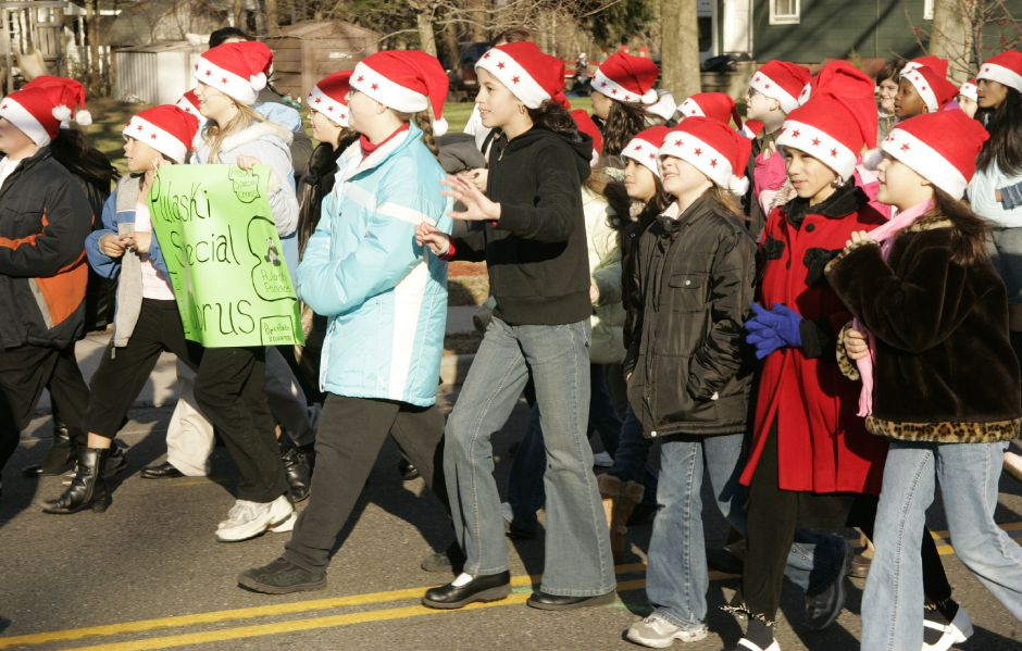 Members of the Pulaski School Special Chorus march in the Christmas in the Village parade Sat. afternoon, Dec. 2 down Main St.