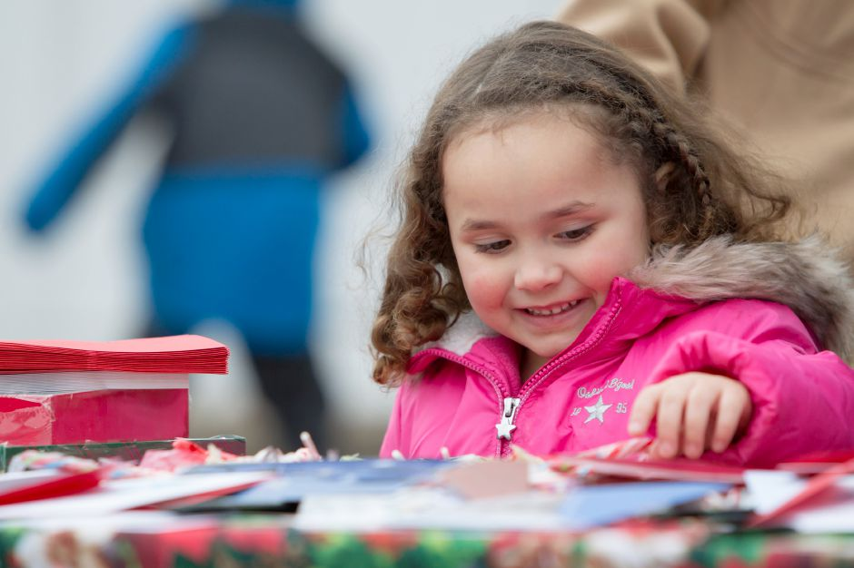 Mya Massaro 4 picks out a card to sign for veterans Saturday during Christmas in the Village on Main Street in South Meriden December 2, 2017 | Justin Weekes / For the Record-Journal