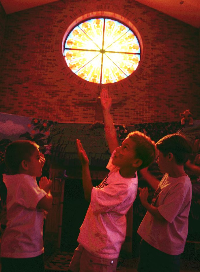 Nicholas Moshier (center) sings praises to God & Jesus at St. Dominic Church Bible School in Southington Aug. 6, 1999.
